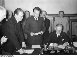Von Ribbentrop signing the Molotov-Ribbentrop pact on Aug. 23, 1939 (with Stalin behind him). The treaty contained a secret protocol outlining how Central Europe would be divided between the two powers (German Federal Archives)