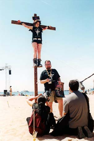 "Publicity stunt for ""Jesus Christ Vampire Hunter"" on a Cannes beach featuring Robyn Whaley on the crucifix"