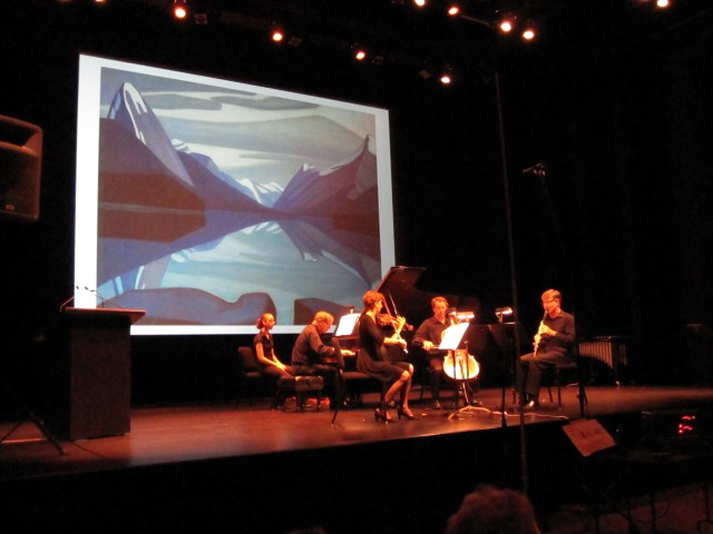 "The painting ""Maligne Lake"" by Lauren Harris is the backdrop of a performance of Mack's composition of the same name, part of his piece ""A Canadian Gallery"""