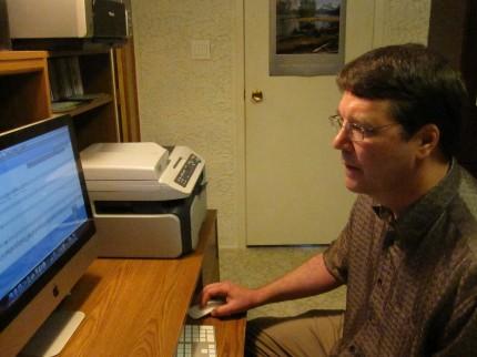 Mack at work composing in his studio