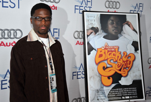 "Dortch at AFI Fest beside the ""Black & Sexy"" poster, which features Nana Hill"