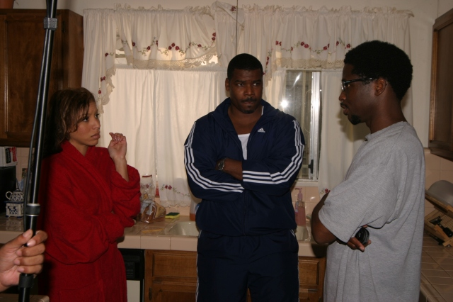 "Dortch discussing an unscripted scene for the vignette ""Her Man"" with actors Chonte Harris and Marcuis Harris"