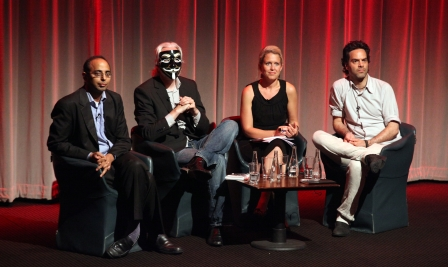 A panel discussion in London, U.K. following a screening of Shadows of Liberty on May 24, 2012. From left to right: Pratap Chatterjee, executive director of CorpWatch; Julian Assange, editor-in-chief of WikiLeaks; Jen Robinson, director of legal advocacy at the Bertha Foundation; and Tremblay (photo courtesy of Jean-Philippe Tremblay)