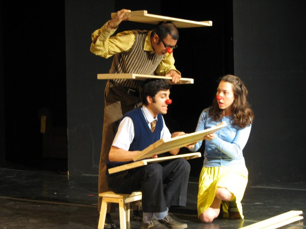 "Ravi Jain, Paolozza and Katrina Bugaj play clowns trying to put together Ikea furniture in ""Tools"" (photo by Bertold Weisner)"