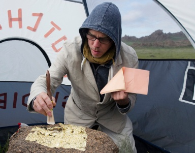 "Bruce Conkle gilding a rock for an art piece in the 2012 ""Mongolia 360° Land Art Biennial"" (photo by Marne Lucas)"