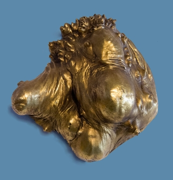 "Philosophers Burl - Tri-Orbular (maple burl, brass leaf) from Conkle's 2010 exhibit ""Magic Chunks"" (photo by Marne Lucas)"