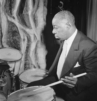 """Drummer Warren """"Baby"""" Dodds (1898-1959) in New York City in 1946 (public domain photo by William P. Gottlieb)"""