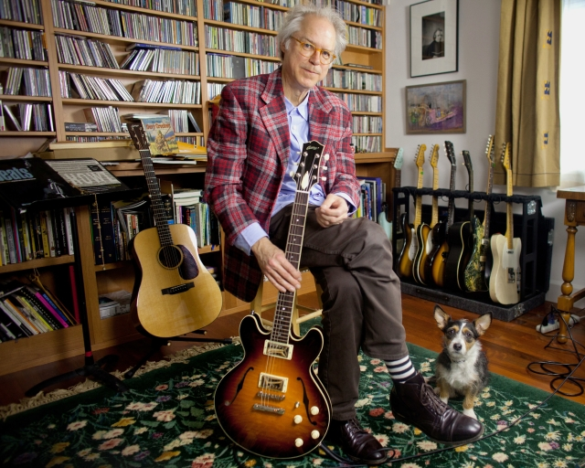Bill Frisell in 2012 in his Seattle, Washington home with his CD collection, some of his guitars, and dog Lucy (photo by Monica Frisell)