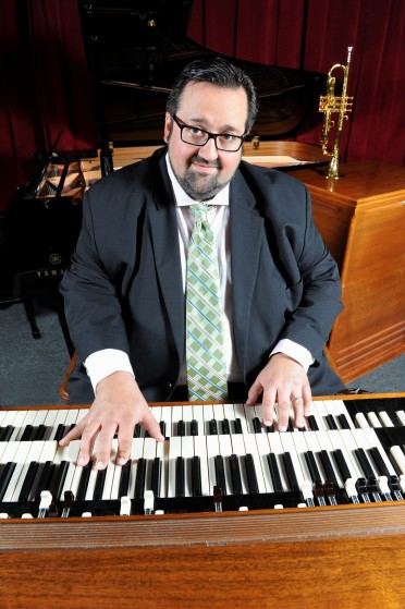 Joey DeFrancesco at the organ with a trumpet, which he began learning while on tour with Miles Davis, in the background (photo courtesy of Joey DeFrancesco)
