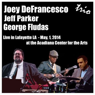 A concert poster featuring the Joey DeFrancesco Trio (L to R) DeFrancesco, Jeff Parker (guitar) and George Fludas (drums).