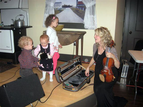 "Natalie MacMaster in Nova Scotia in 2010 with her three eldest children (Mary Frances, Michael and Clare) during the launch of her book ""Celtic Aire,"" a photographic tribute to Cape Breton (photo by Kimberley, courtesy of nataliemacmaster.com)"