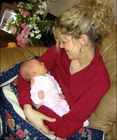 Natalie MacMaster in 2005 with her firstborn child, daughter Mary Francis Rose Leahy (photo courtesy of nataliemacmaster.com)