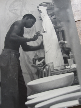 Maxwell Taylor as a young man in the late '50s decorating a religious piece for Chelsea Pottery (photo courtesy of Maxwell and Therese Taylor)