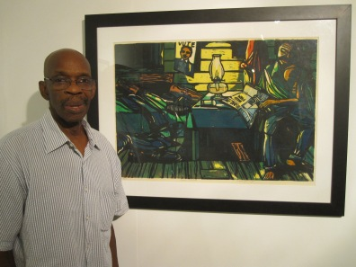 "Maxwell Taylor at the National Art Gallery of the Bahamas on Oct. 8, 2014 with his 1982 linocut reduction ""Damn Politics"" (photo by Anita Malhotra)"
