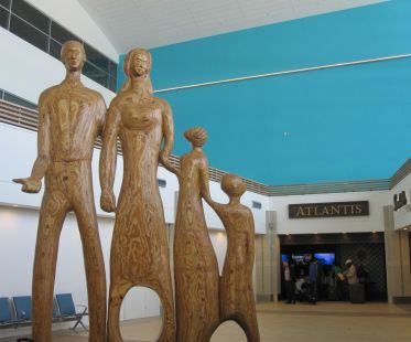 """The Family,"" a plywood sculpture by Maxwell Taylor at Lynden Pindling International Airport in Nassau, Bahamas (photo by Anita Malhotra)"