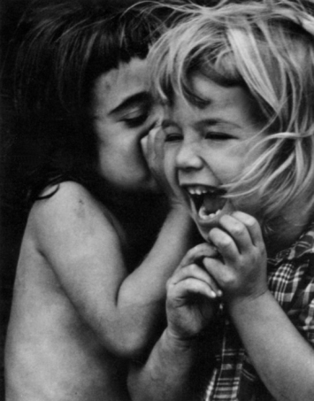 """Philadelphia [girls sharing a secret],"" 1954, by David Heath (b. 1931) (© Dave Heath / Courtesy of Stephen Bulger Gallery)"