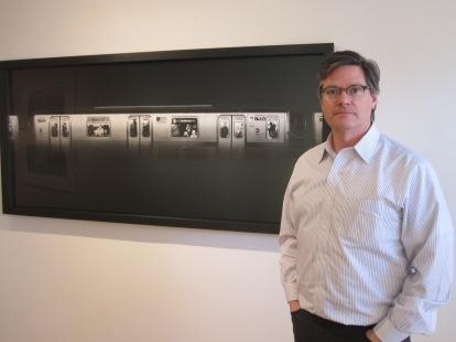 "Stephen Bulger posing beside ""Stainless 7492,"" New York, 2010, by Adam Magyar (© Adam Magyar, Stephen Bulger Gallery) [photo by Anita Malhotra]"
