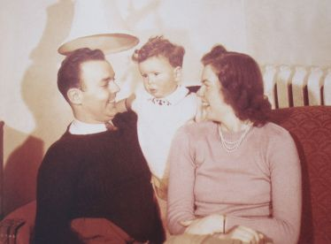 Bruce in 1947 as a toddler with his parents in Kingston, Ontario (photo courtesy of Bernie Finkelstein and Bruce Cockburn)