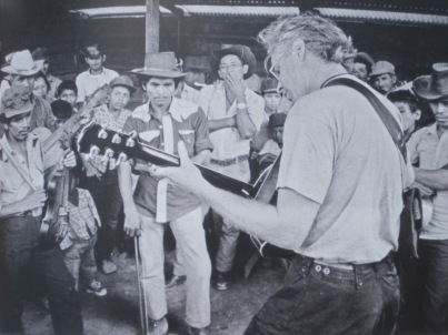 Bruce Cockburn performing while on a 1985 mission to a refugee camp in Colomancagua, Honduras, (photo courtesy of Bernie Finkelman and Bruce Cockburn)