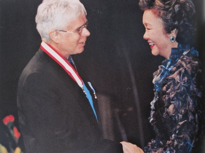 Cockburn in 2002 receiving promotion to the rank of Officer in the Order of Canada from Governor General Adrienne Clarkson (photo courtesy of Bernie Finkelman and Bruce Cockburn)
