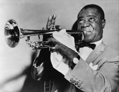 Louis Armstrong (1901-1971), the famed American trumpet player and singer, in 1953 (public domain photo from Wikimedia Commons)
