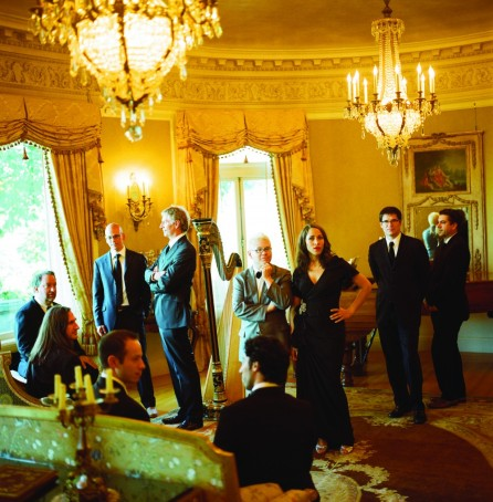 Pink Martini posing at Pittock Mansion, a Renaissance-style château in Portland, Oregon (photo by Autumn de Wilde)
