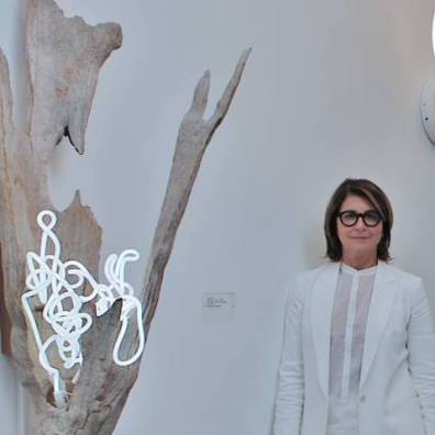 "Lisa Schulte with her work ""Untitled Wood Series #7"" (photo courtesy of Lisa Schulte)"