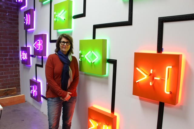 "Lisa Schulte with her neon sculpture ""Conversation"" at her Los Angeles studio on Feb. 17, 2017 (photo by Anita Malhotra)"