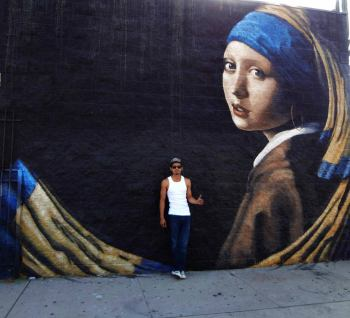 "Levi Ponce with his mural ""Dia de Pacoima"" (""Girl with a Hoop Earring""), painted in 2017 (photo courtesy of Levi Ponce)"