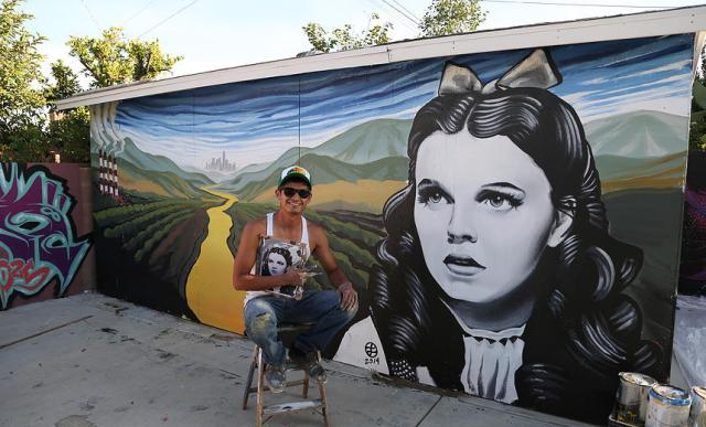 "Levi Ponce with his mural ""Dorothy"" (photo by Javier Martinez)"