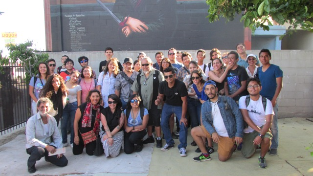 Levi Ponce (centre) with his father (far left) giving a mural tour to students from Mexico City's U.N.A.M. university (photo by Hector Ponce)