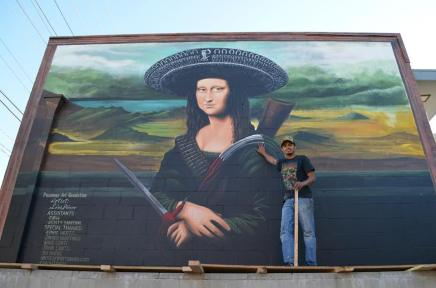 "Ponce with his mural ""Ramona Lisa,"" painted in June 2012 with the assistance of R@H and Kristy Sandoval (photo by Javier Martinez)"