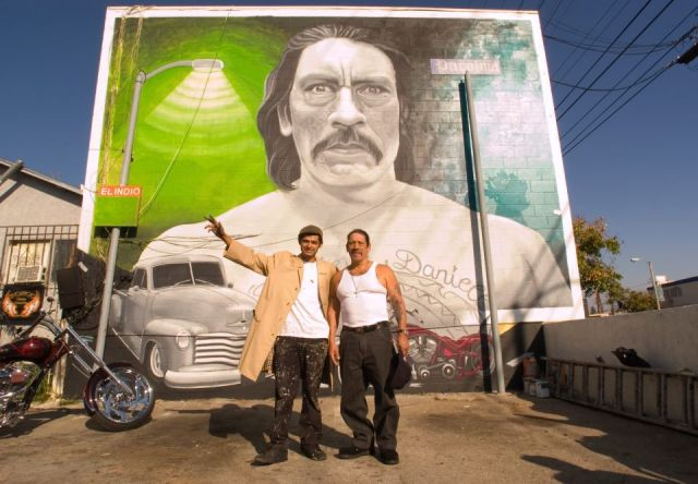 Levi Ponce with actor Danny Trejo (R) in front of Ponce's December 2011 mural of Trejo (photo courtesy of Levi Ponce)