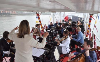 Anne Dudley on the River Thames conducting one of her compositions at the Queen's Diamond Jubilee celebrations in London in June 2012 (photo courtesy of Anne Dudley)