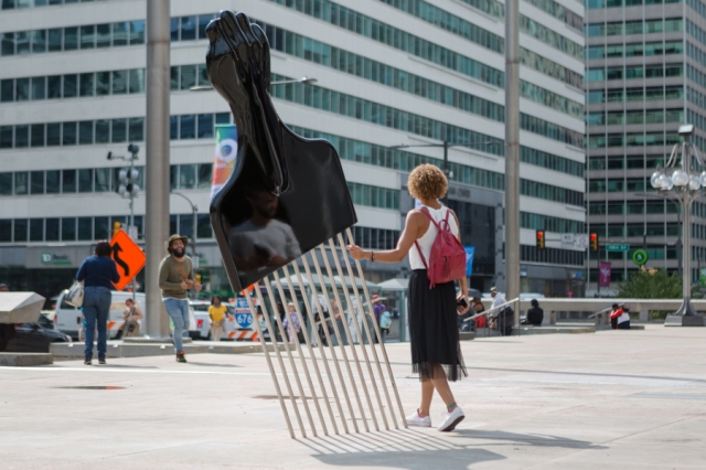 "Hank Willis Thomas' 2017 public sculpture ""All Power to All People"" in Philadelphia (photo by Steve Weinik courtesy of Hank Willis Thomas and Philadelphia Mural Arts)"