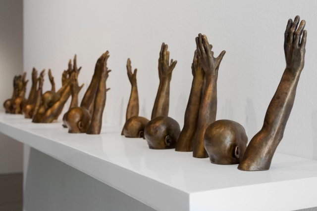 "Thomas' bronze sculpture ""Raise Up,"" part of the work exhibited for the 2017 Aimia 