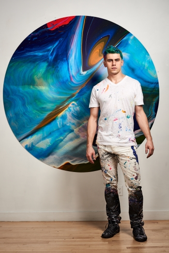 "Callen Schaub with one of the paintings in his show ""The Arena"" at The Sussex Contemporary gallery in Ottawa (photo by Collateral Photography - Spencer Robertson)"
