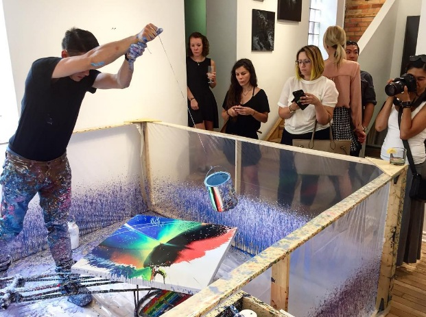 Schaub in a live painting performance (photo by Devan Patel of Artworks Consulting & Project Gallery)
