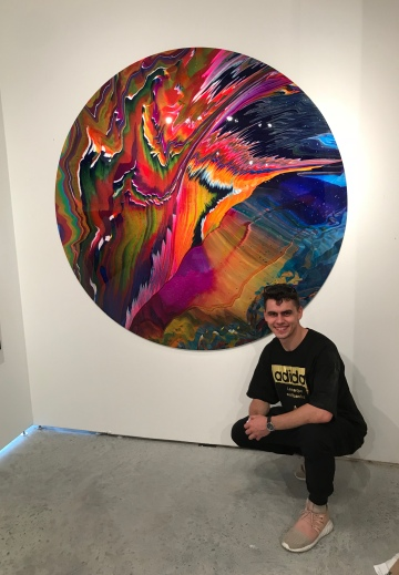 Callen Schaub with one of his paintings at the Art Basel Fair in Miami (photo by Callen Schaub)
