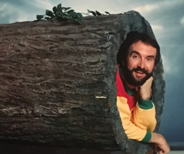 "Penner posing in the signature hollow log for his CBC children's show ""Fred Penner's Place"" (photo courtesy of Fred Penner)"