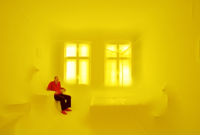 """Saturday afternoon, at home in Neukölln"" (1995), latex balloon/air/artist/living room; lightbox slide, 43 x 62 cm, © Hans Hemmert and VG Bild Kunst"