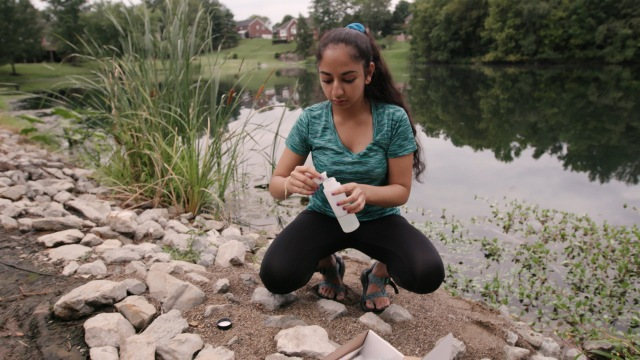 Anjali Chadha taking water samples for her ISEF project research (photo courtesy of National Geographic)