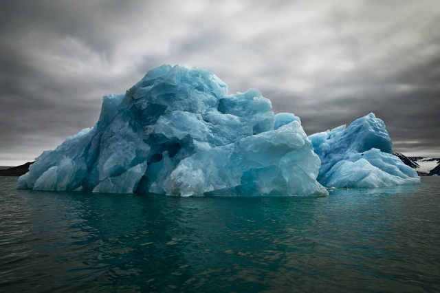 The Last Iceberg Series III: Blue Underside Revealed II, Svalbard, July 5, 2010 (photo © Camille Seaman)