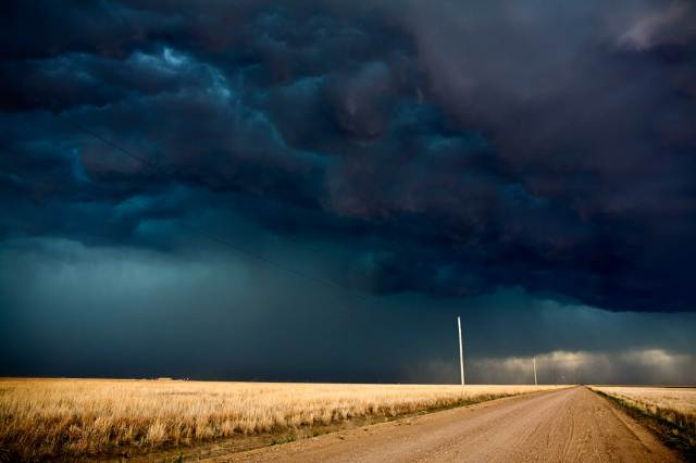 The Big Cloud: Rain over Fields of Gold, Kansas, 2008 (photo © Camille Seaman)