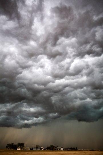The Big Cloud: Each Year We Pray (photo © Camille Seaman)