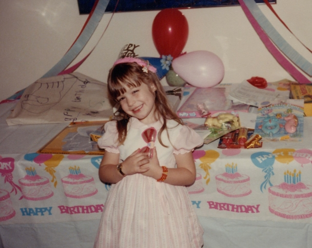 Sandra Beasley as a young girl celebrating her birthday (photo courtesy of Sandra Beasley)