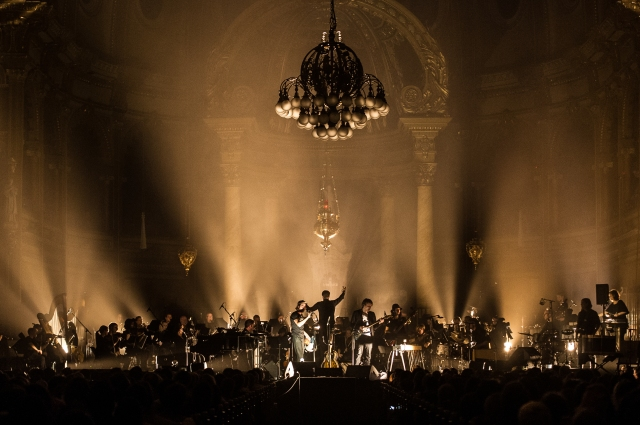 Patrick Watson and his band performing with an orchestra (photo courtesy of Patrick Watson)