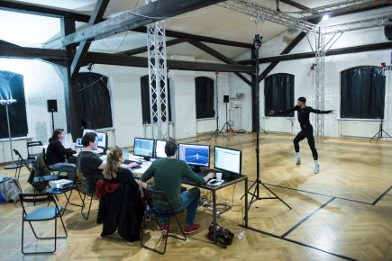 "A dancer in the motion capture studio for ""Das Totale Tanz Theater"" (© Interactive Media Foundation)"