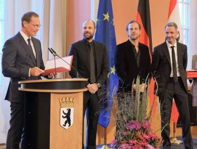 Christopher and Marc Bauder's inauguration with the Order of Merit of the State of Berlin for the installation LICHTGRENZE (photo courtesy of WHITEvoid)