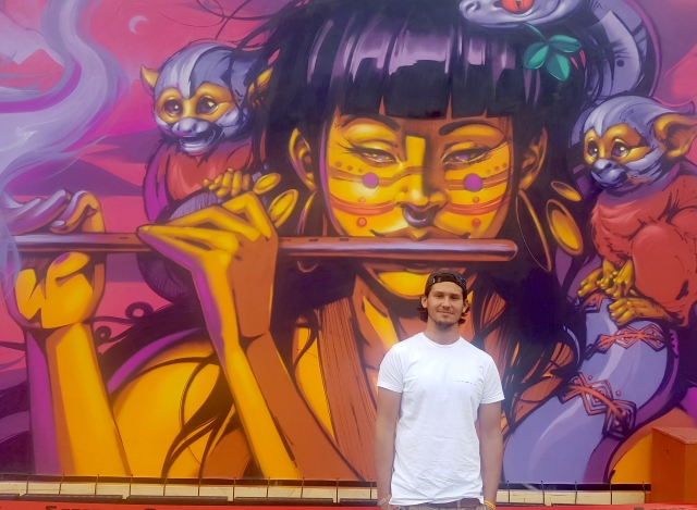 Nasca Uno in front of the mural he created for the 2019 Berlin Lollapalooza music festival (photo by Anita Malhotra, Sept. 7, 2019)